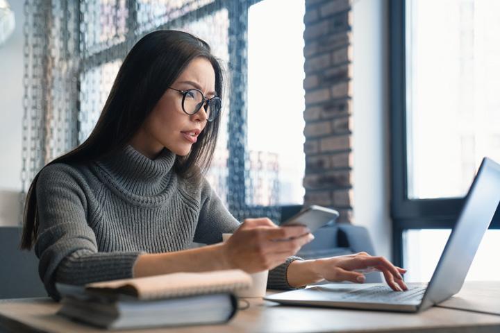 Woman sat working on laptop