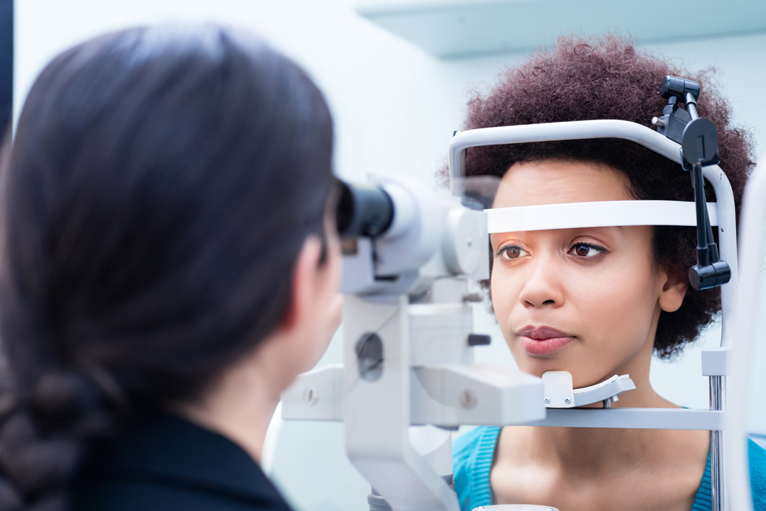 Woman having a slit lamp examination