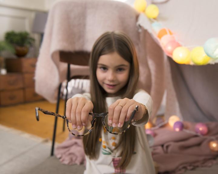 Girl holding glasses