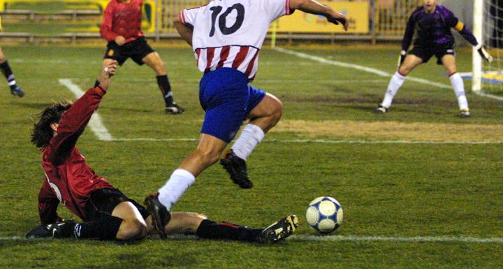 Footballer avoiding a tackle