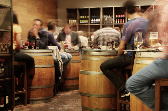 Bar scene with barrel tables