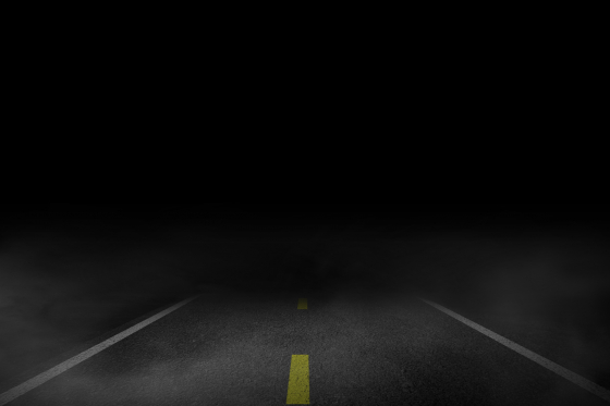 Driving at night on a dark road