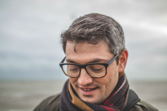 man wearing glasses outside