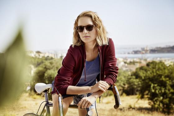 Woman riding a bike wearing Transitions