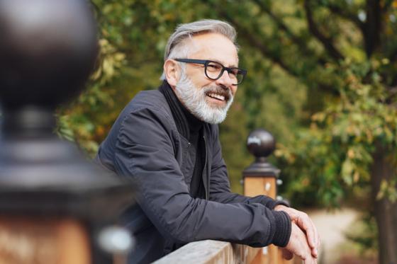 Man wearing varifocal lenses outside smiling