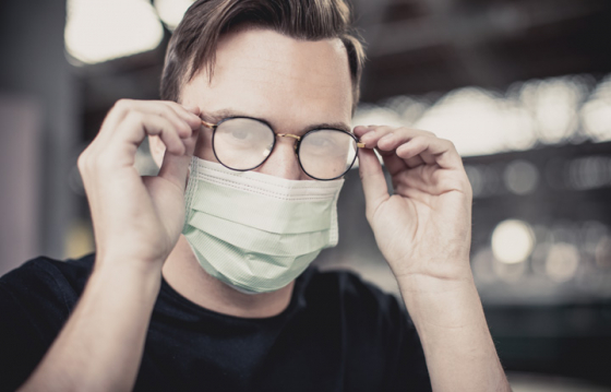 Man with steamed up lenses due to wearing face mask