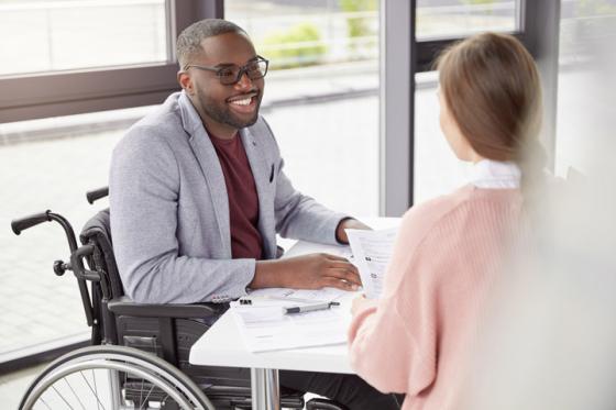 Man sat in meeting wearing glasses