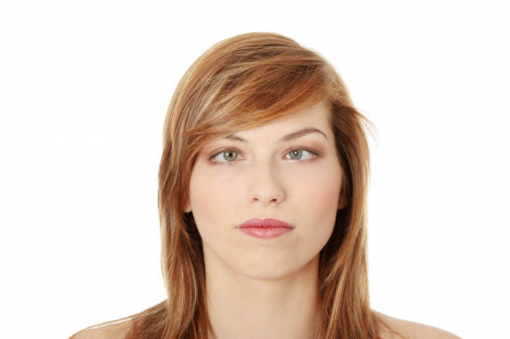 a woman with her eyes squinting