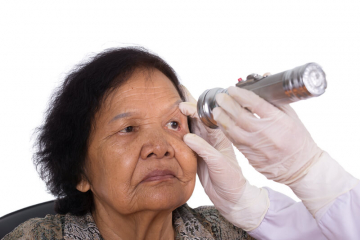 eye being examined by a doctor